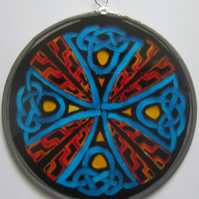Suncatcher - Celtic Knot Cross in orange, red, yellow, black and blue - Medium