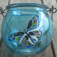 Cauldron shaped blue tea light holder with hand painted butterfly