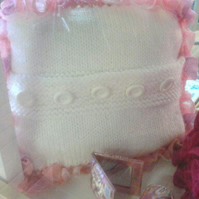 Cushion, hand knitted, white with pink, lilac frill.   40cms. pad included.
