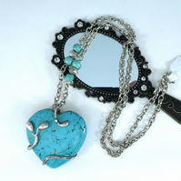 Lovely Turquoise Gemstone Pendant enhanced with entwined soldered tendrils