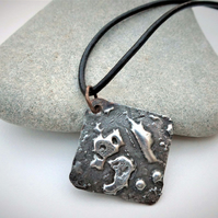 Stamped Solder Pendant, using lead free solder on leather cord