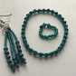 Very pretty Teal crystal, Dangle Earrings, Bracelet and stretchy ring set