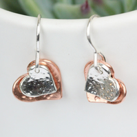Silver and copper textured two heart drop earrings