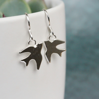 Polished silver swallow earrings