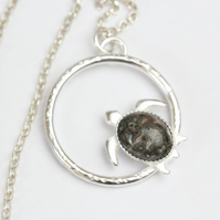 Silver turtle necklace with a leopard agate