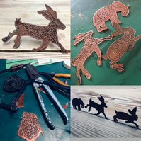 Hare brooch made of etched copper.