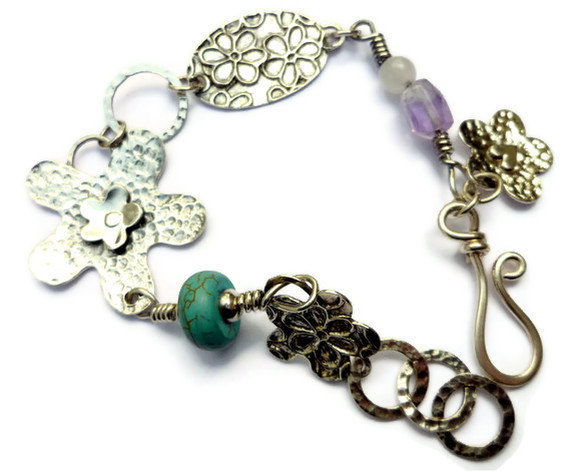 Silver bracelet with flowers