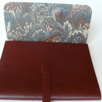 Leather Book. Rosewood grained leather lined with a hand made marbled paper.