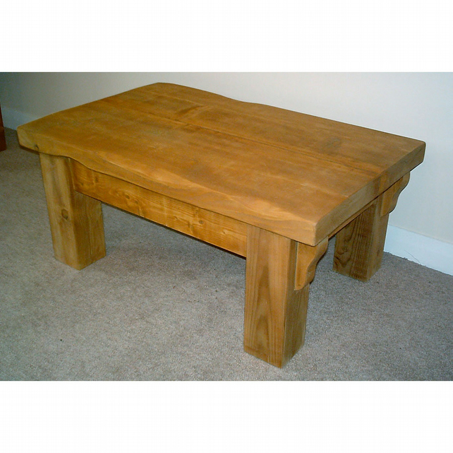 Chunky handmade rustic coffee table with decorative supports
