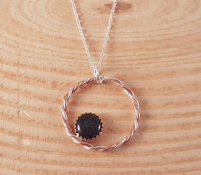 Sterling Silver and Copper Twisted Circle with Copper Set Blue Goldstone