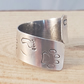 Sterling Silver Stamped Foot and Paw Print Cross Over Adjustable Ring