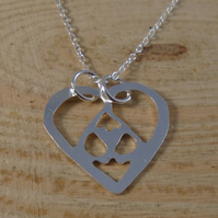 Sterling Silver Pierced Hearts Necklace
