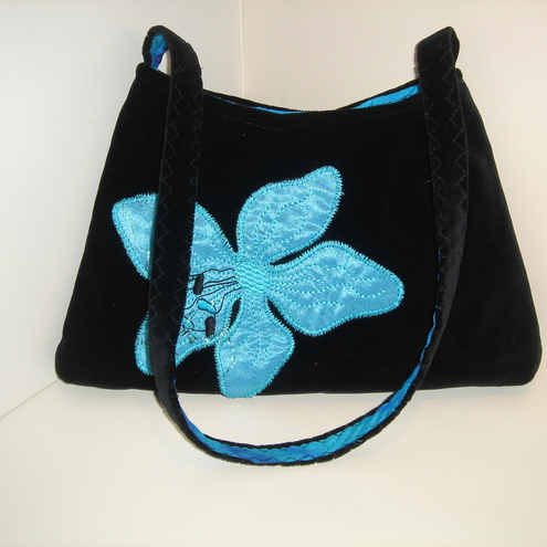 Turquoise and black evening bag