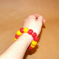 Yellow and red felt ball bracelet