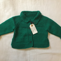 Hand knitted baby cardigan - green