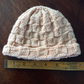Hand knitted baby hat - cream