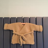 Hand knitted baby wrap cardigan - caramel