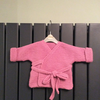 Hand knitted baby wrap cardigan - pink