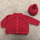 Red chunky knit cardigan with bobble hat