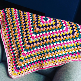 Bright granny square lap blanket - pink