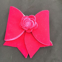 Lovely large Pink Velvet bow finished with a rose