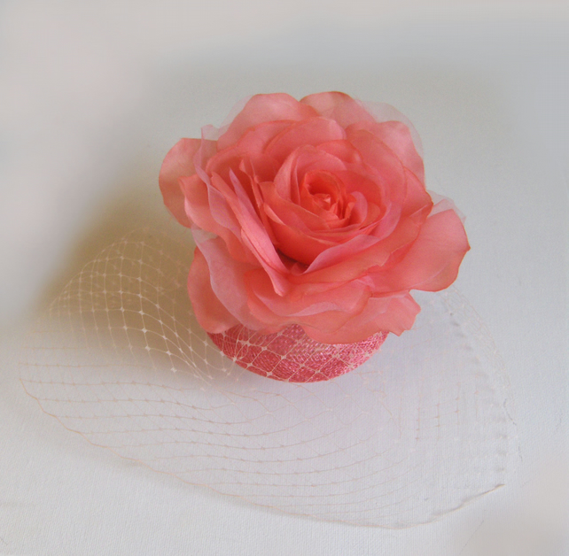 Flamingo peach rose fascinator.