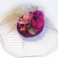 Magenta orchid cocktail hat.