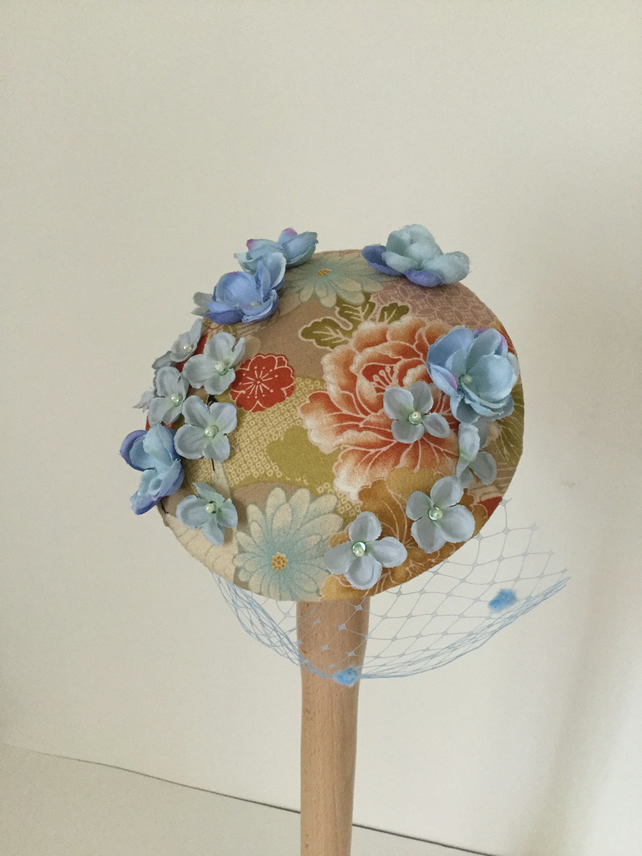 Japanese Sakura blossoms veiled fascinator, gold and blue.