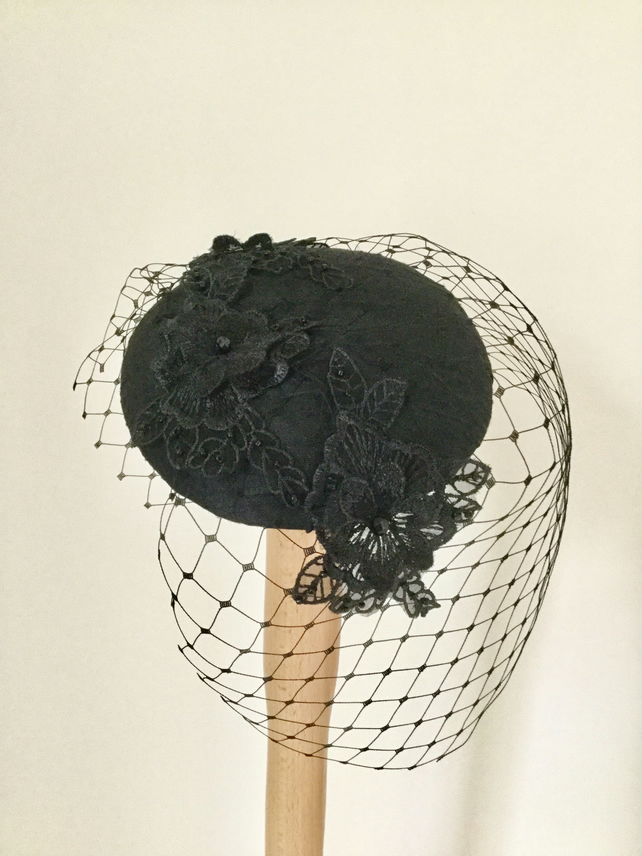 Black birdcage veil fascinator.