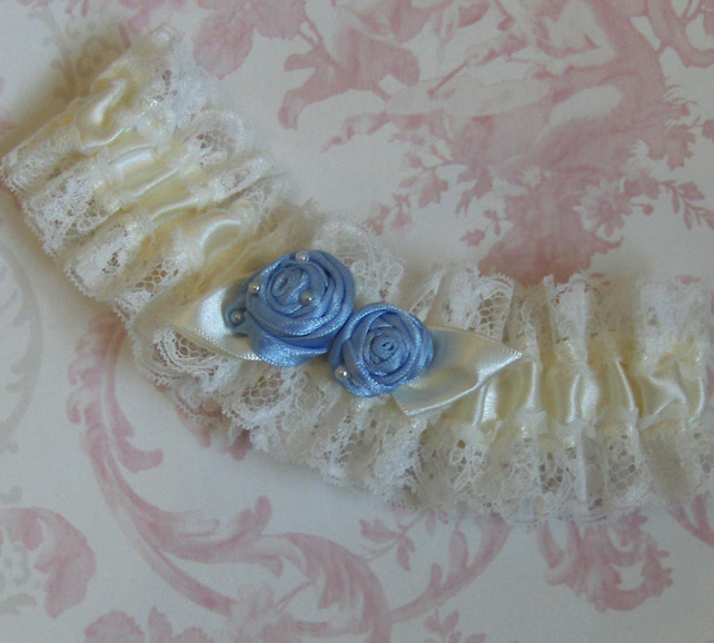 Ivory Bridal Garter With Blue Rolled Roses.