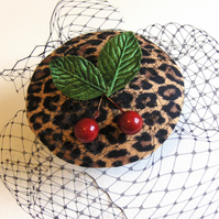 Leopard print cherry topping fascinator