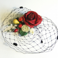 Winter rose, veiled fruits fascinator.