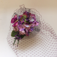 Smokey purple floral veiled fascinator.