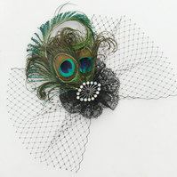 Peacock feather veil fascinator.