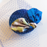 Blue silk bow cocktail hat.