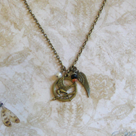 Mockingjay necklace.