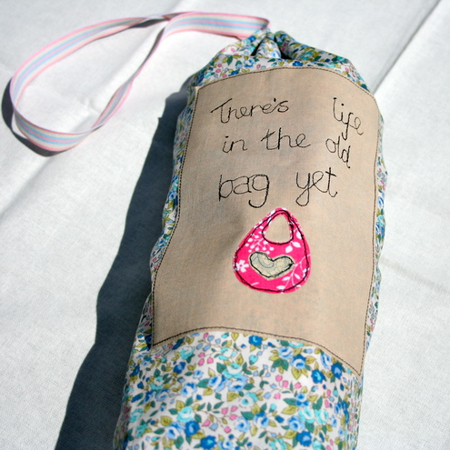 Reduce, resuse, recycle. Embroidered carrier bag holder dispenser