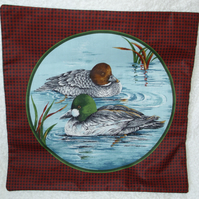 Pair of Ducks ( Pochards ? ) paddling quietly among the reeds cushion