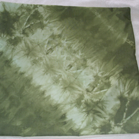 Olive green tie dye cushion, feathers and flowers