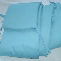 Turquoise cot bumper.