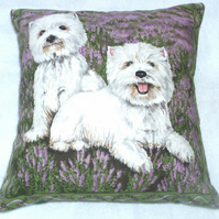 Two Westies side by side in the heather waiting for some fun cushion