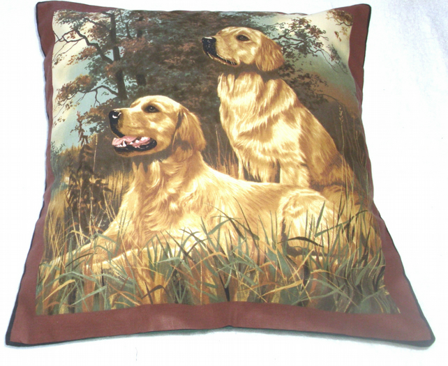 Two golden retrievers ready and waiting cushion