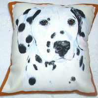 Portrait picture of a Dalmation pup facing forward cushion,
