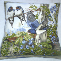 Bright Blue Swallows on a Summer day cushion