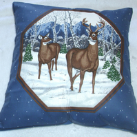 Deer and Stag standing in a wintry forest cushion