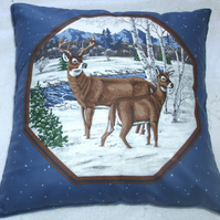 Deer and Stag standing by a river in a wintry forest cushion