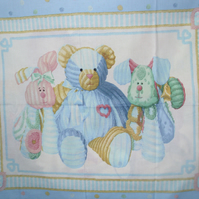 Blue-teddy-and-Bunny-and-Doggy-friends-cot-quilt