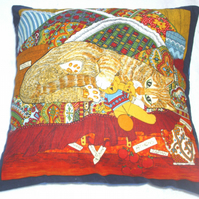 A Ginger tabby kitten among colourful blankets cushion