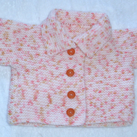 Hand Knitted pale peach and orange coat for baby 0 to 3 months