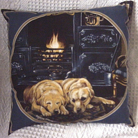 Two golden Labradors resting in the kitchen cushion